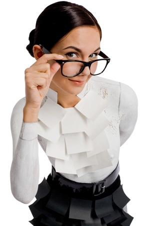 Portrait of flirtatious businesswoman in eyeglasses looking at camera with smile photo