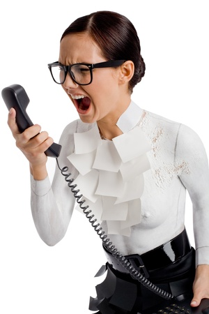 woman screaming: Photo of angry female holding phone receiver and shouting into it Stock Photo