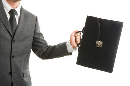Close-up of businessman with briefcase in hand isolated on white background photo