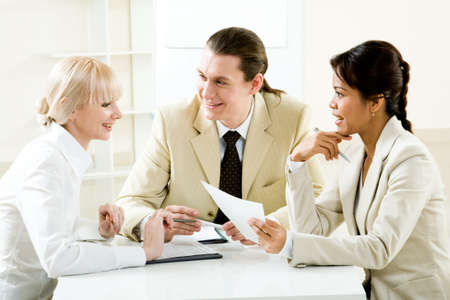 Photo of company of successful people planning work in office photo