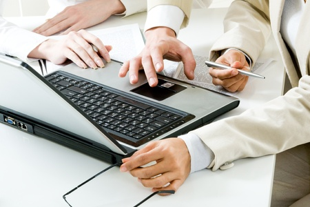Photo of human hands near laptop at workplace during teamwork Stock Photo - 8434631