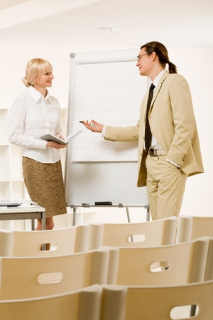 Photo of successful businessman sharing ideas by whiteboard to pretty partner Stock Photo - 8434520