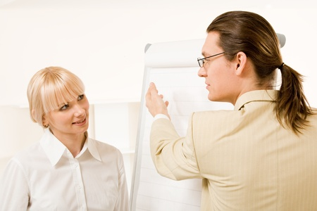 Photo of successful businessman explaining his ideas by whiteboard to attentive partner Stock Photo - 8434547