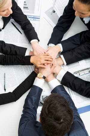Image of business people with their hands on top of each other symbolizing partnership Stock Photo - 8447581