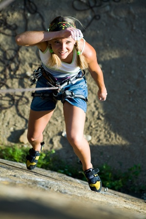 Image of woman hanging on the rope and looking at camera Stock Photo - 8447535