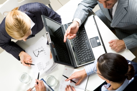 Above view of business people working with documents at meeting Stock Photo - 8448011