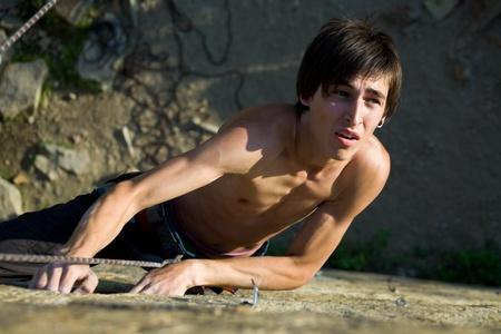 rockclimb: Photo of man climbing up the mountain  Stock Photo