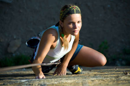 Image of female climber with rope climbing  Stock Photo - 8447536
