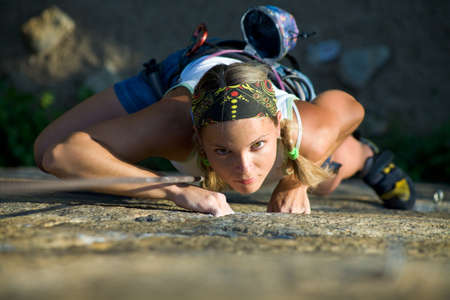 rapelling: Vertical image of woman doing exercise on the mountain  Stock Photo