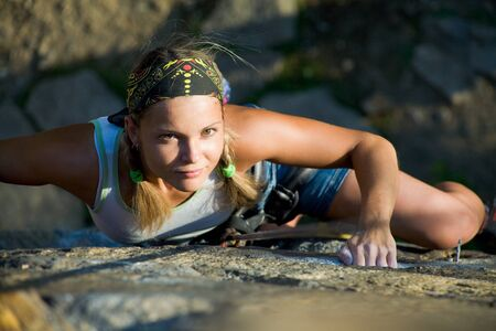 rapelling: Image of blonde lady climbing on the rock  Stock Photo