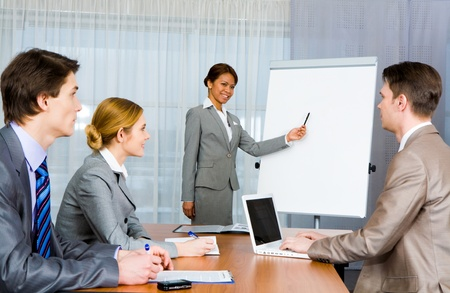Photo of confident employer teaching business people how to manage organization Stock Photo - 8447582