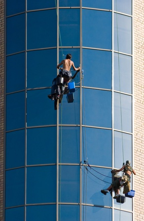 rapelling: Image of people climbing up the wall of building