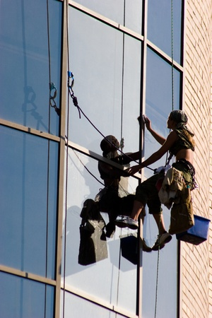 rapelling: Image of woman washing a window  Stock Photo
