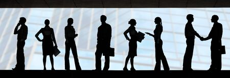 interacting: Several silhouettes of businesspeople interacting over blue background