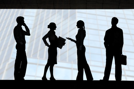 Four outlines of business partners with communicating females between two men photo