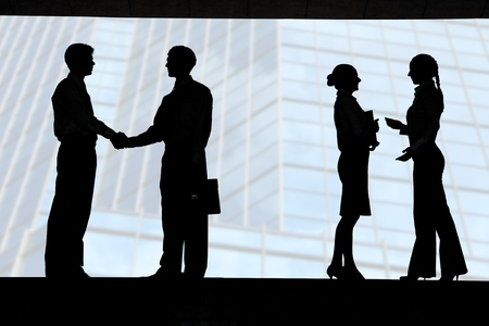 Outlines of business partners handshaking with two communicating females near by photo