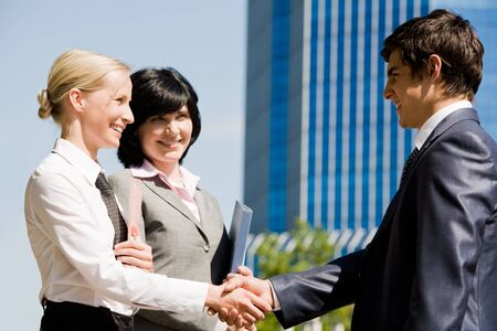 Photo of successful associates handshaking after striking deal outdoors at meeting Stock Photo - 8447850