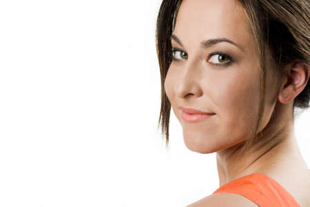 Face of pretty girl looking at camera with smile over white background photo