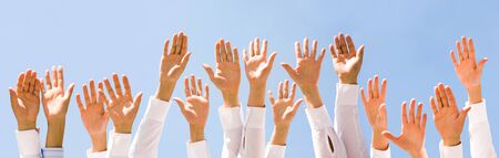 Close-up of several human hands raised against cloudy sky Stock Photo - 8454080