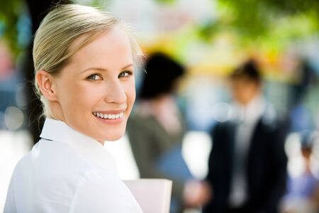 lifestyle looking lovely: Image of pretty female looking at camera in green park Stock Photo