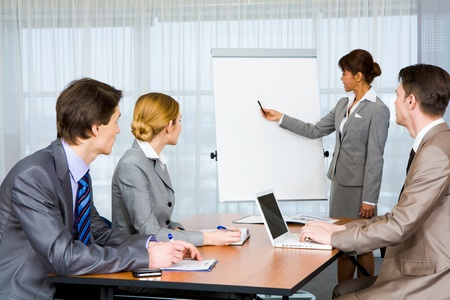 Photo of attentive business partners listening to smart teacher presenting new project Stock Photo - 8451893