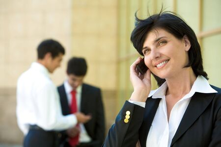 Portrait of pretty boss talking by mobile phone with smile Stock Photo - 8451958