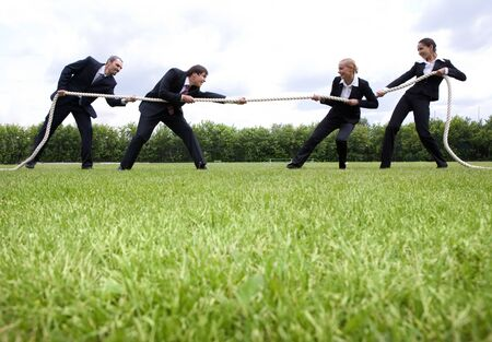 tug of war: Image of business people standing in the stadium and playing