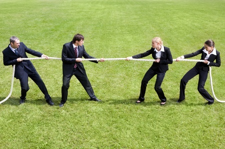 Photo of tug of war between business people  photo