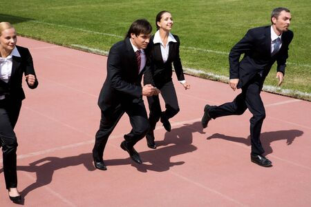 Image of employees running on sport track  photo