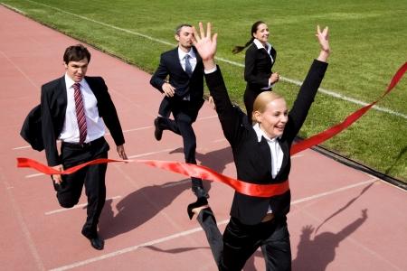 Foto van ondernemers kruising van de afwerkingslijn Stockfoto