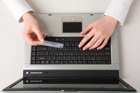 View above of hand holding credit card and buying Stock Photo - 8451261