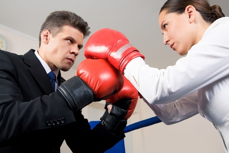 red competition: Photo of aggressive business partners in boxing gloves fighting with each other