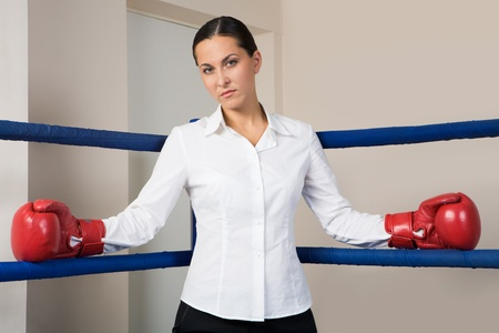 Portrait of strict businesswoman in boxing gloves looking at camera Stock Photo - 8448158
