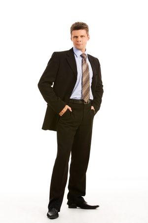 Vertical image of successful boss standing in studio Stock Photo - 8448118