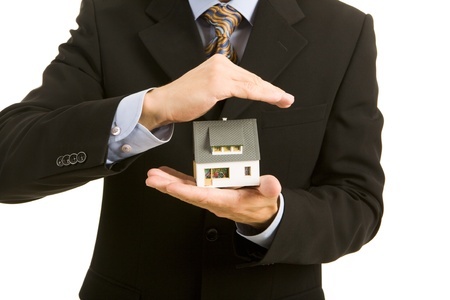 immovable: Horizontal image of house in businessman�s hands
