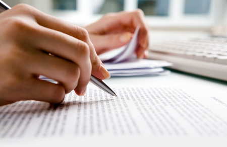 business report: Close-up of secretary�s hands doing paperwork   Stock Photo