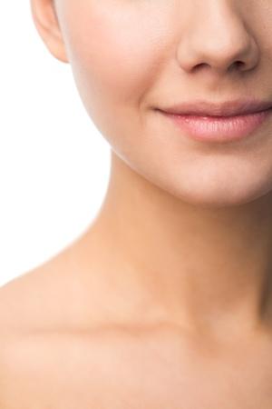 nose: Foto del giovane sorridente femminile in isolamento Archivio Fotografico