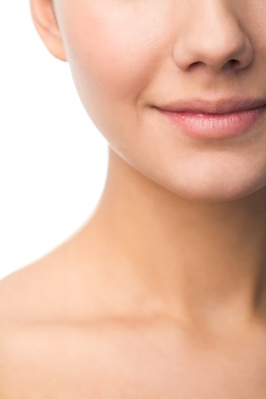 nose close up: Photo of young female smiling in isolation Stock Photo