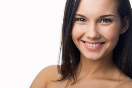 Portrait of charming girl looking at camera and laughing Stock Photo - 8448172