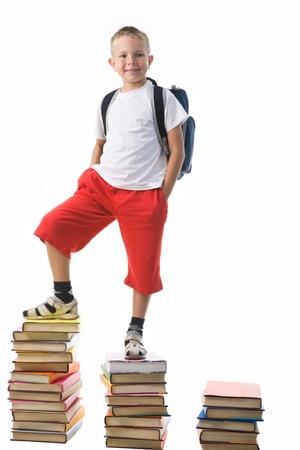 diligent: Diligent preschooler standing on the top of book stairs