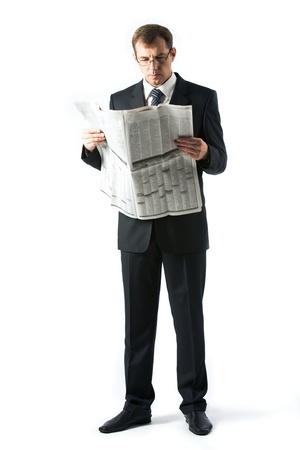 reading newspaper: Vertical image of successful boss reading newspaper in studio Stock Photo
