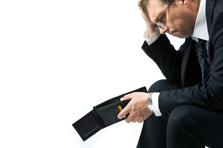 Image of sad businessman holding empty wallet and grieving  photo