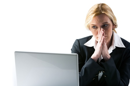 Photo of frustrated businesswoman looking at laptop display and thinking at work photo