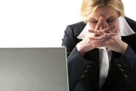 Photo of depressed female being worried by problems in business photo