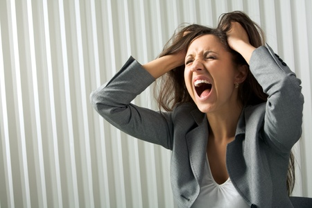 Photo of depressed female screaming in desperation photo
