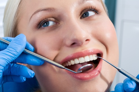 Close-up of young woman during inspection of oral cavity with help of hook and mirror Stock Photo - 8455185