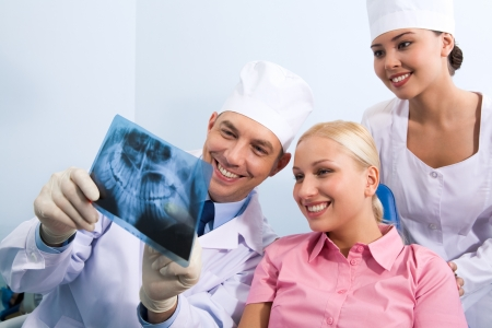Image of young lady with dentist showing her x-ray photography Stock Photo - 8455093