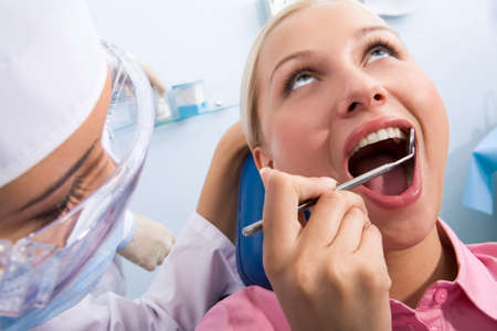 Image of young woman during inspection of oral cavity with help of mirror Stock Photo - 8455074