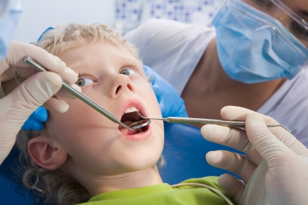 oral cavity: Photo of little boy having mouth checkup in dental clinic