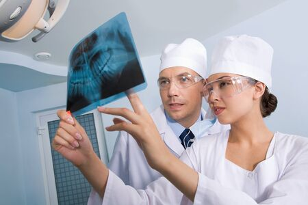 Image of young lady with dentist showing her x-ray photography Stock Photo - 8455110